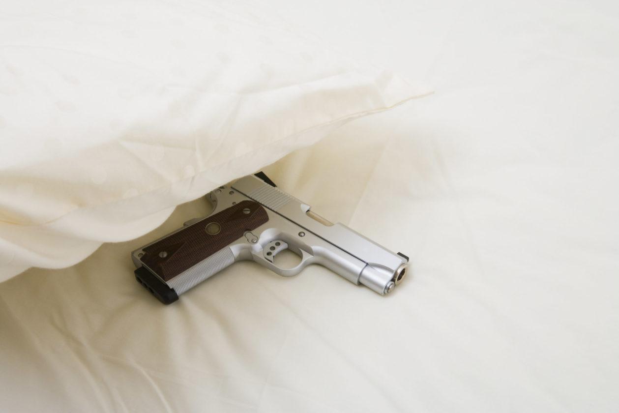 Handgun under a pillow